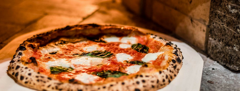 a pizza from The Brick Oven