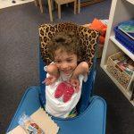 Bennett laughing in a highchair